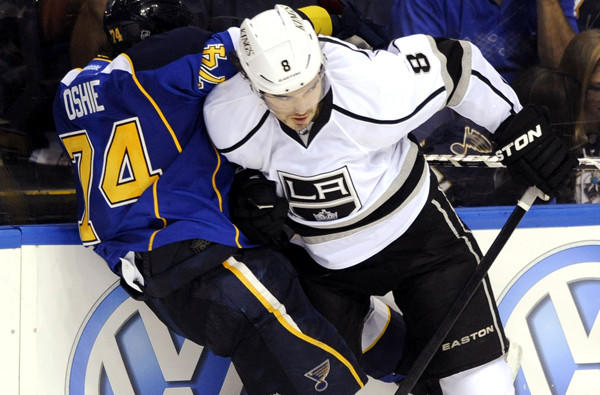 Kings defenseman Drew Doughty collides with Blues winger TJ Oshie in overtime of Game 1 on Tuesday night in St. Louis.