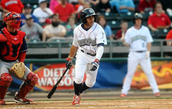 Lehigh Valley IronPigs' Cesar Hernandez follows through on his swing during their game with the Pawtucket Red Sox at Coca-Cola park in Allentown Tuesday April 9, 2013.