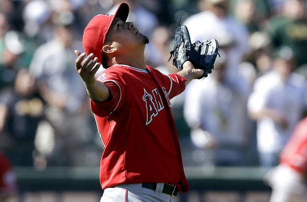 Angels closer Ernesto Frieri celebrates after recording the final out against the A's on Wednesday afternoon in Oakland.