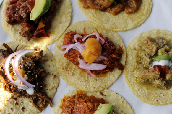 "The taco sampler at Guisados includes <i>bistek en salsa rojo</i>, front, along with <i>cochinita pibil</i>, <i>chuleta en salsa verde</i>, <i>tinga</i>, <i>mole poblano</i>, and <i>chicarron</i>.<br><br><b>Details:</b> 2100 E. Cesar Chavez Ave., Los Angeles, (323) 264-7201, and 1261 W. Sunset Blvd., Los Angeles, (213) 250-7600, <a href=""http://www.guisados.co/"" target=""_blank"">Guisados.co</a>"