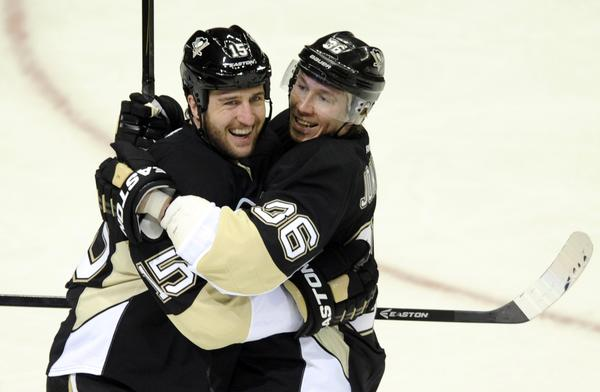 Penguins' Tanner Glass celebrates his second period goal against the Islanders with Jussi Jokinen.
