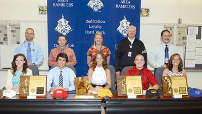Five Windber Area High School student-athletes announced their intentions to play collegiate sports Wednesday. They are, front row from left: Jenna Bracken, Jacob Hanley, Ashlee McMullen, Garrett Walerysiak and Danielle Walsh. Coaches and faculty members are, back row from left: Garrett Wright, Brett Hoffman, Lisa James, principal, Todd Bostock, athletic director and Joe Podrebarac
