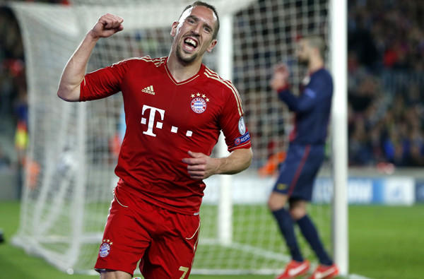 Bayern Munich's Franck Ribery celebrates after FC Barcelona defender Gerard Pique, background right, deflected a shot into the goal in the Champions League semifinal on Wednesday.