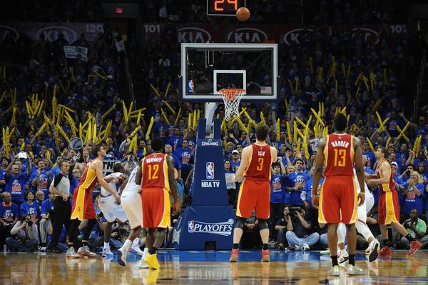 The Rockets' Omer Asik attempts a free throw after being fouled repeatedly by the Thunder during the second half.