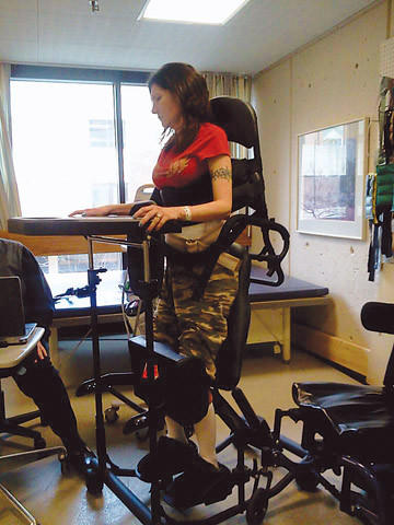 Michelle Vining of Aberdeen is going through physical therapy in Sioux Falls after her immune system attacked her nervous system, leaving her mostly paralyzed.