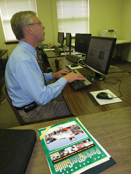 Aberdeen Cultural and Recreation Center supervisor David Eckert works on the Webtrac software program that, come Saturday, will allow ARCC patrons to register for summer programs and classes online.