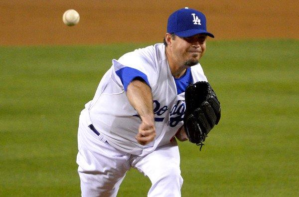 Dodgers starting pitcher Josh Beckett labored through 83 pitches on Wednesday night in a 7-3 loss to the Colorado Rockies.