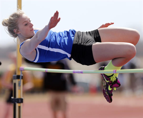 Alexis Clark of Aberdeen Central goes over the bar during the high jump at the Al Sahli Invitational last weekend at Swisher Field. Clark is currently tied for first among Class AA competitors with a leap of 5-feet 7-inches. She also has the top pole vault mark and is third in both the long jump and the triple jump.