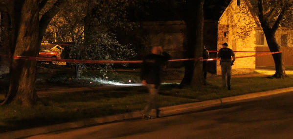 Police near evidence of a police-involved shooting early Thursday morning.