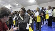 New claims for jobless benefits fell sharply to 324,000 last week, the lowest level in 5 years.