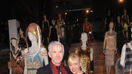 "Director/producer/writer Baz Luhrmann must be pretty proud of his latest offering, ""The Great Gatsby,"" due out May 10. At least it looked that way Tuesday night in New York at Prada's cocktail reception kicking off the SoHo store's exhibit of the movie's costumes, designed by Luhrmann's wife, Oscar-winning costume designer Catherine Martin, in collaboration with fashion designer Miuccia Prada. One might say he embodied the phrase ""busting his buttons"" (as seen here). Some of the movie's stars -- Carey Mulligan, Tobey Maguire and Isla Fisher -- attended, as did Katy Perry, Florence Welch and Maggie Gyllenhaal. <a href=""http://www.wwd.com/eye/parties/prada-opens-great-gatsby-exhibit-in-new-york-6916075?module=hp-hero-topstories"">[WWD]</a>"
