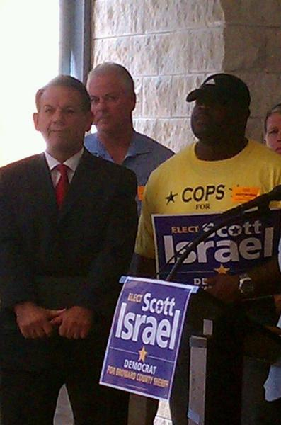 Sheriff Scott Israel during his campaign, with supporter Raymond Hicks, right. Bob Pusins, now at BSO, is to the rear.