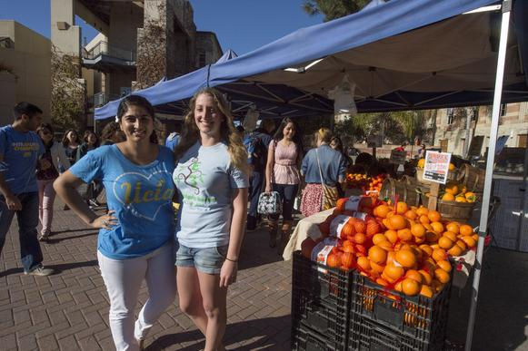 UCLA seniors Jasneet Bains, left, and Joanna Wheaton manage the market on th