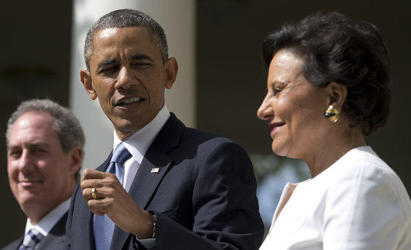 President Obama looks to longtime fundraiser and philanthropist Penny Pritzker in the Rose Garden of the White House.