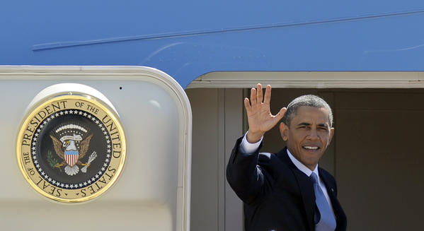 President Obama waves from the steps of Air Force One at Andrews Air Force Base, Md., as he boards a flight for Mexico.