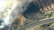 A brush fire along the 101 Freeway in Camarillo has spread to 100 acres and is still growing, fire officials said.