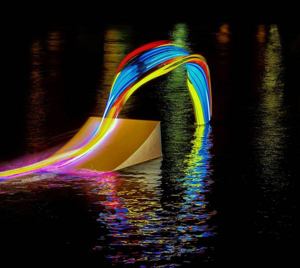Motion to Light. Light Painting Wakeboard. This photo by Patrick Rochon is part of a project between sports and art in collaboration with Red Bull and Snap! Orlando. Rochon worked with professional wakeboarders in Orlando during a nighttime run. Multicolored lights were mounted to the wakeboards and time-exposures allowed the colors to streak through the image. (photo buy Patrick Rochon)