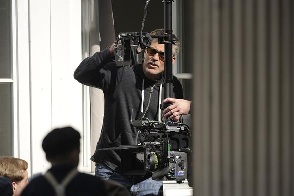 "Actor and director George Clooney works on setting up a shot for ""The Monuments Men"" in Goslar, Germany. The film is being shot in several locations in Lower Saxony and other areas of Germany."