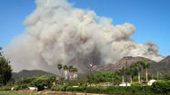 A strong Santa Ana wind is fueling the fast-growing Springs fire in Camarillo and Newbury Park, where numerous motor homes were destroyed and hundreds of homes are threatened.