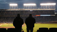 The Cubs met with Wrigley Field rooftop owners and neighbors Wednesday to show their plans for the $300 million ballpark renovation.