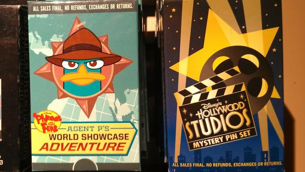 Agent P's World Showcase Adventure pins and Disney's Hollywood Studios Mystery Pin Set don't let the buyer know what's in the box.
