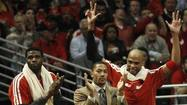 Derrick Rose cheers on the Bulls with Nazr Mohammed and Taj Gibson. (JIM YOUNG / REUTERS / April 26, 2013)