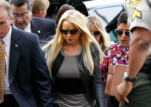 Lindsay Lohan arrives at the Beverly Hills Courthouse to begin serving her 90-day sentence for a probation violation.