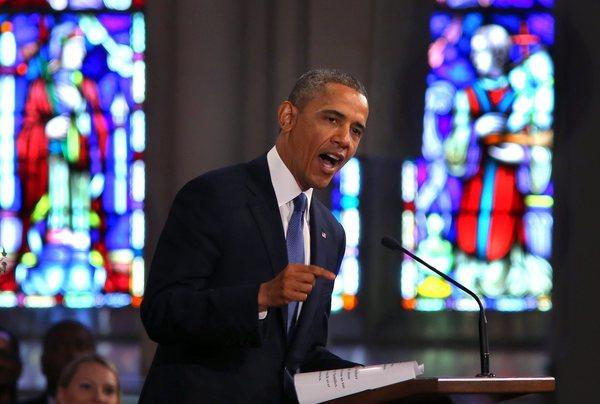 President Obama speaks at an interfaith service for victims of the Boston Marathon bombings at the Cathedral of the Holy Cross in Boston.