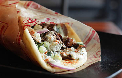 "<b>Gyros: </b>At the seemingly gazillion gyro shops around, most serve meats that arrive in wheel form -- that is, resembling and bearing the flaccidity of shoe insoles. No, I'm not knocking it because I grew up on that specific taste and I'm fond of that smooth, preformed, meatloafish texture. But <b>Covo Gyro Market </b>, the 6-month-old Wicker Park fast-casual from the owners of Prasino, doesn't serve that kind of gyro. They source their hormone-free meats from a Wisconsin farm, which are then hand-packed on the spit each day: lamb on top of beef, on top of lamb, etc. At Covo, comparisons to Chipotle are unavoidable. You walk up to the counter, choose your vessel, protein, then topping. There are chicken, pork and vegetarian options available, but I opted for the standard-issue lamb-beef gyro ($7.50 for regular, $3.80 for mini). That familiar gyro meat texture everywhere else isn't present. Rather, Covo's is less rubbery, more fibrous with crispier heat coil-exposed nubs and end pieces. You know, what grilled meat actually tastes like. Pitas are made-in-house, too ¿ crisp along the edges, warm and soft in the center. This isn't some radical re-imagining of the gyro; it's one that ticks every requirement box on the checklist. (For the record, it's pronounced year-oh.) Covo Gyro Market, 1482 N. Milwaukee Ave., 312-626-2660  <p>— <a href=""http://bio.tribune.com/KevinPang"">Kevin Pang</a></p>"