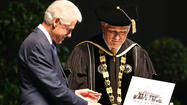 To the roar of cheering graduates, former president <strong>Bill Clinton</strong> received on honorary doctorate degree from University of Central Florida president Dr. <strong>John Hitt</strong> during the commencement ceremony for the College of Health and Public Affairs and the College of Medicine's Burnett School of Biomedical Science, at UCF in Orlando, Fla., Thursday. Clinton was the keynote commencement speaker at the graduation ceremony.