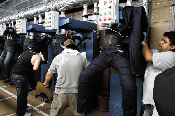 "Workers in South Gate make premium denim pants for AG Jeans. An AG executive said the company will do what makes ""the most business sense,"" which might include shifting some production to Mexico."
