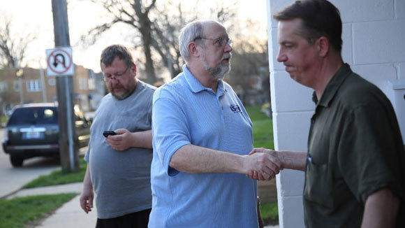 Members of the United Steel Workers Local 1343 in South Milwaukee gather Tuesday after rejecting a proposed six-year contract from Caterpillar.
