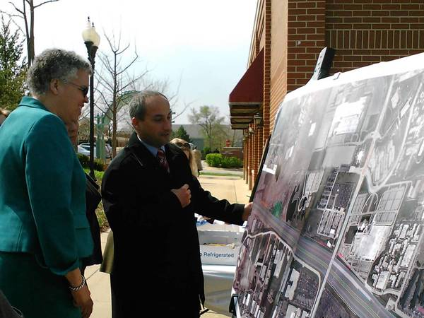 John Yonan, the county's superintendent of transportation and highways, shows a map of the Schaumburg road improvement project to Cook County Board President Toni Preckwinkle.