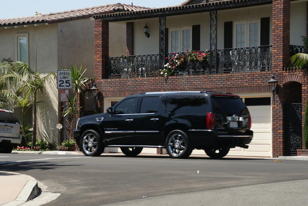 A black Escalade SUV carrying Lindsay Lohan drives around Lido Isle on Thursday afternoon across from the Morningside Recovery facility where she was scheduled to undergo rehab.