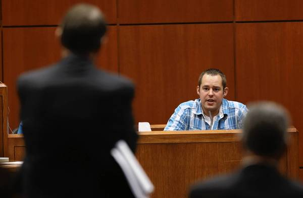 Derek Janssen, former mechanic at Bill Jacobs BMW in Naperville, testifies during the Johnny Borizov trial at the DuPage County Courthouse in Wheaton, Illinois.