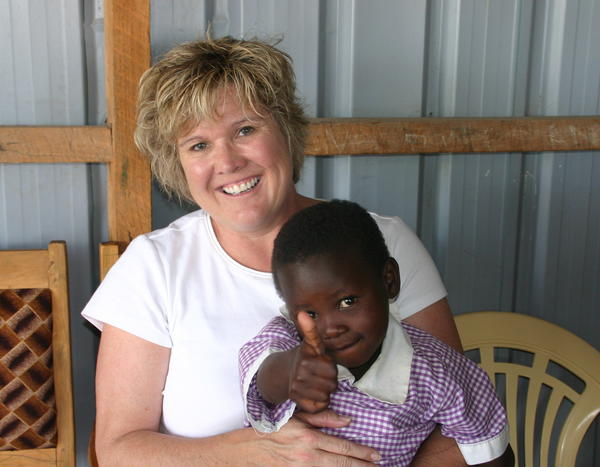Jene Meece with an orphan at Fanaka Primary School in Athi River, Kenya.