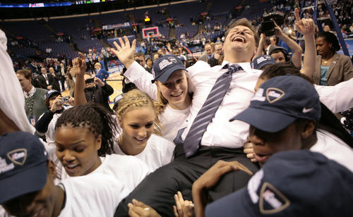 UConn coach Geno Auriemma is carried off the court after the Huskies beat Louisville 76-54 in the NCAA Tournament final to cap a 39-0 season, giving Auriemma his sixth national championship.