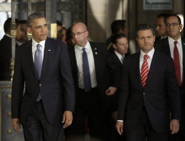 President Obama, left, and Mexican President Enrique Pea Nieto, right, arrive for a news conference at the National Palace in Mexico City.