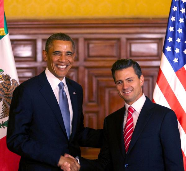 President Obama, left, is seen shaking hands with Mexican President Enrique Pena Nieto during a joint press conference at the National Palace in Mexico City.