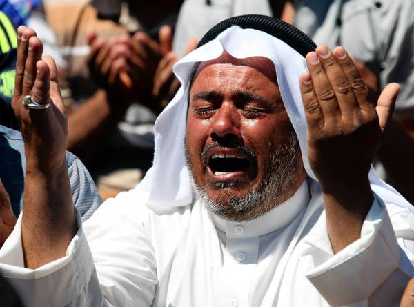 A Sunni protester prays during an anti-government demonstration in Iraq last month. The United Nations announced Thursday that April was the bloodiest month for Iraq in five years, with at least 712 people killed.