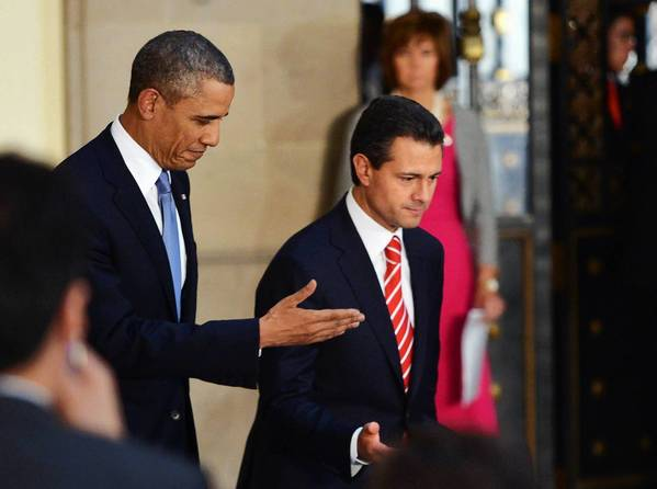 "President Obama, with Mexican President Enrique Pena Nieto in Mexico City, said the U.S. would ""interact"" with Mexican agencies in ""any way that the Mexican government deems appropriate."""