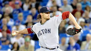 Boston Red Sox pitcher Clay Buchholz is one of the hottest players in baseball, leading the majors with a 6-0 record, but a Toronto Blue Jays radio color commentator believes he knows the young right-hander's secret: He's cheating.