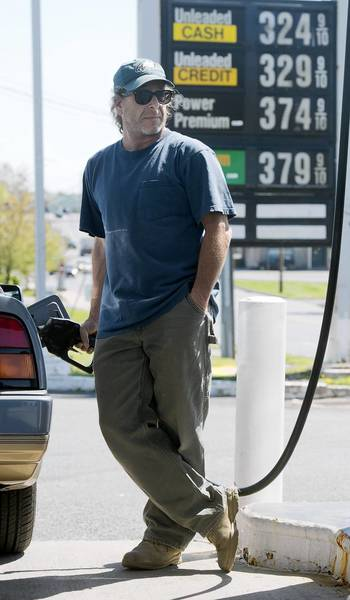 Kirk Jacobson, of Breinigsville, pumps gas at Truck Stop Gas Station on Airport Road in Allentown Thursday. Like the analysts, he doesn't expect to see prices fall below $3.