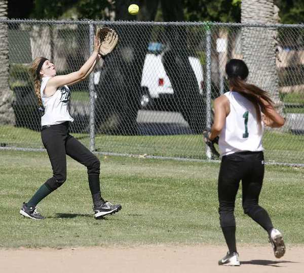 Providence's Dominique Dominguez catches the ball as Ashley Corral watches during a game against Faith Baptist on Thursday, May 2, 2013.