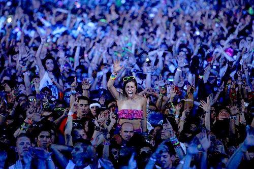 Rave fans dance during a set by DJ David Guetta during the second day of the Electric Daisy Carnival at the Las Vegas Motor Speedway. The EDC is one of the largest electronic music festivals in the world.