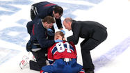 Montreal Canadiens forward Lars Eller was removed on a stretcher after he fell face-first on the ice from the impact of a violent hit during Thursday night's NHL playoff game against the Ottawa Senators.