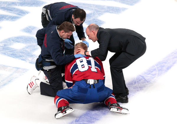 Canadiens center Lars Eller gets assistance after being hurt during the second period against Ottawa.