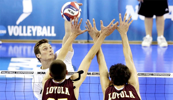 Zack La Cavera hits against Loyola-Chicago's Thomas Jaeschke and Nicholas Olson in the second set of UC Irvine's sweep of the Ramblers on Thursday night at Pauley Pavilion in the NCAA men's volleyball semifinals.