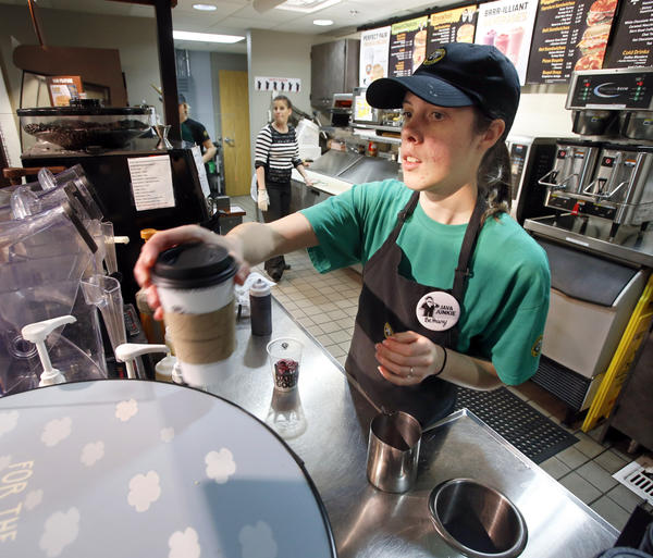 Bethany Booze, a graduating senior at Northern State University, serves up a drink during her shift at Einstein Bros. Bagels on Wednesday at the NSU Student Center.