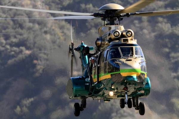 A helicopter takes part in the search for two hikers missing in the Trabuco Canyon area of Orange County in April. After one was charged with drug possession, officials are considering billing them for the costs of a multi-day search and rescue.
